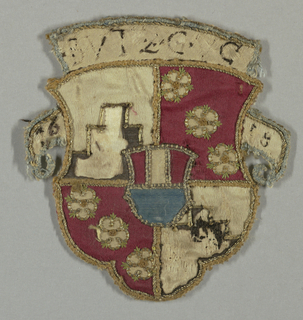 "Shield divided into quarters alternately white satin with black satin blocked peak with couched gold outlines, and crimson satin with three five-lobed white satin rosettes with couched gold outlines, silk embroidered detail. Small superimposed shield of white crimson, blue satin, in center. Embroidered lettering in curving white satin field across top; ""BVTZGVG;"" curved banderole on either side of shield ""16-18."" Outlines in couched metal cord."