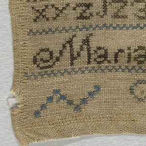 Bands of alphabets and numerals separated by simple cross borders, with the inscription Maria Atwater. The lower band is unfinished. Embroidered in light blue, grey-green, pale yellow, and brownish-black.