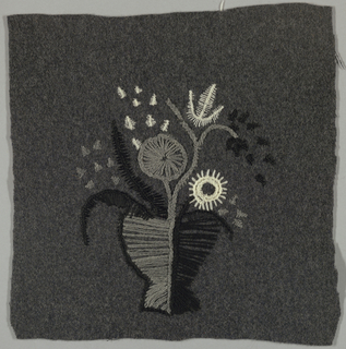 Square, dark grey wool, embroidered in white, grey and white wool in design of a floral bouquet in an abstracted vase form.