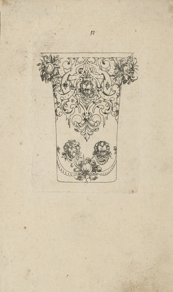 Scrollwork frieze on top and two masks over drapery festoons below.