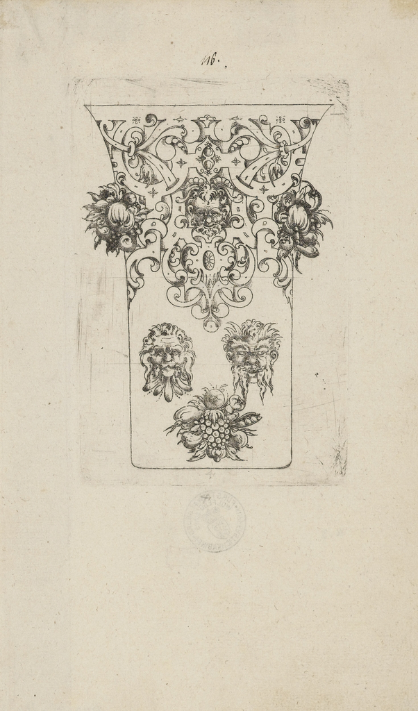 Scrollwork frames a mask and clusters of flowers protrude from the sides at top. Below, two masks (a lion on the left and a man on the right) are presented above grapes and flowers.