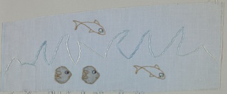 Fragment of light blue cotton embroidered in white and blue in an abstract design of waves. Additional pattern of swimming fish embroidered in metallic thread.