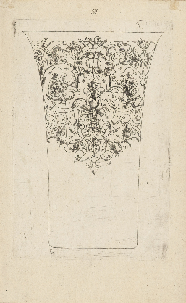Scrollwork frieze with a carnation in the center.