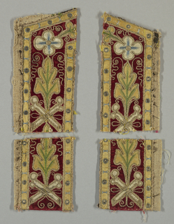 Four fragments of an embroidered band have stylized leaves and rosettes within yellow borders. Yellow and white appliqué on red velvet.