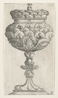 A covered stemmed goblet with scalloped petals covering body and lid with flower bud as finial.