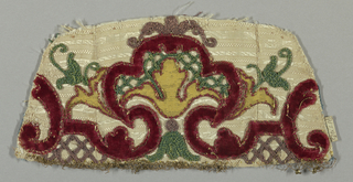 Appliqué of arabesques and flowering forms in yellow silk and red velvet on a white figured silk ground. Couching of colored cords added.
