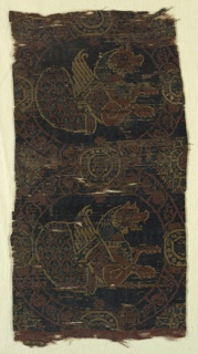 Fragment of woven silk with two tangent roundels, each containing a senmurv.