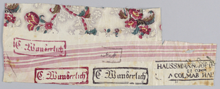 Part of a polychrome floral pattern on a white ground and factory marks. Bands of red weft have been woven into the cloth.