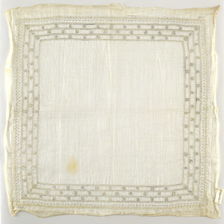 Sheer white handkerchief with an embroidered border.