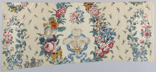 Polychrome fragment with the Prince of Wales feather spray in the center surrounded by flowers. At left and right floral sprays of roses (for England) and thistles (for Scotland). At the lower left, a printed impression of the Garter badge that was added later as it was printed over the floral motifs.