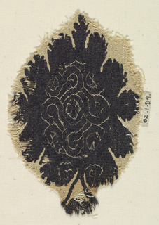 A leaf shape with geometric patterning in the center.
