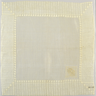 "Large sheer white linen handkerchief with wide drawnwork border. Monogrammed ""S.J.M."" with embroidery in one corner."