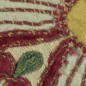 Appliqué of cut-out shapes of red velvet and yellow silk with couched threads on a circle of white silk figured ground.