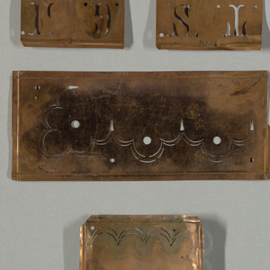 "Set of batik instuments and booklet, containing a batik pencil, metal with wooden handpiece, and metal incising instrument with wooden handle.  Booklet entitled: ""Die Batik - Technik."""