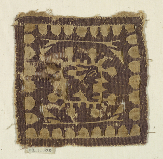 A square, monochrome tapestry, depicting a hare within a scalloped frame.