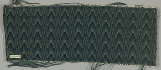 "Bargello effect in shades of deep blue-green, based on ""honeysuckle draft"" worked out in the early 1920s by Mary Meigs Atwater."