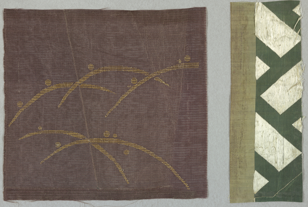 Brown gauze with asymmetrical spaced arcs and dots in gilded paper. Fabric in upper half in pale green strie; lower half is green with bold angular white decorative lines.