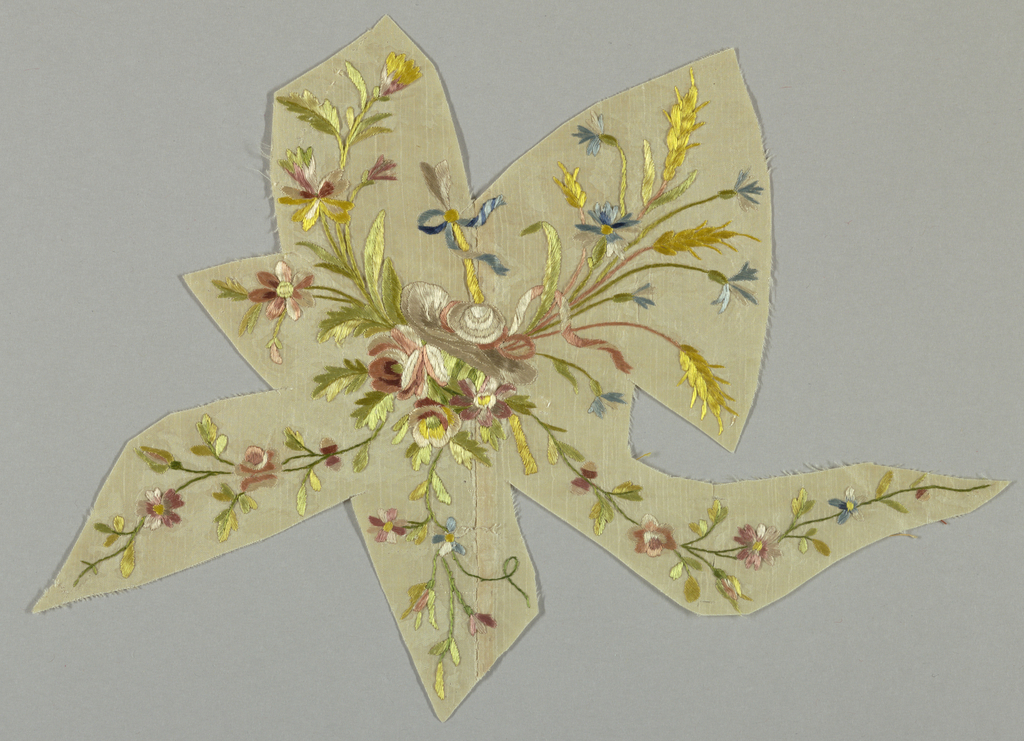 irregular shape with polychrome floral spray; white ground with yellow blossoms and shoots.