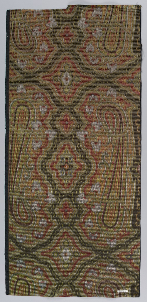 Sample of a heavy compound fabric with horizontal ribbing formed by coarse weft of cotton. Tight arrangement of allover multicolored design based on Persian cone motif and geometric and highly conventionalized plant forms. Left selvedge present.