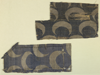 Reversible fabric with silver crescents on a blue ground.