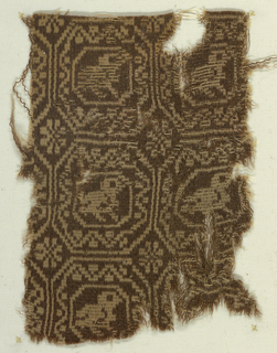 Fragment with a reversible desgin in tan against brown ground on face and the reverse on the back. Design has octagons, each enclosing a bird.