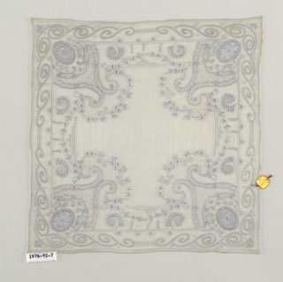 Handkerchief with a pattern of scrolls and flower sprays.