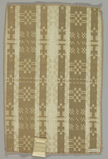 Sample adapted from Cooper Union example 1953-14-6, an early American woven coverlet. The filling yarn is a rayon spun on the wool system.