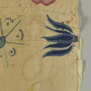 Floral pattern embroidered in stem, herringbone, buttonhole, French knot and other stitches.