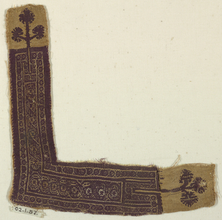 An 'L' shaped border, possibly from a tunic. Monochrome type, purple wool and undyed linen. An interlacing geometric pattern with a three-leafed branch at each end.