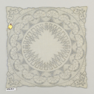 Handkerchief with a design of a large circel filled with profiles of flower heads and semi-circular sprays of flowers.