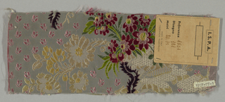 Greenish-gray finely ribbed ground in a Louis XV style with a flower and lace pattern in floss floats in green, off-white, tan, mauve, and deep red. One wide selvedge with double warps.
