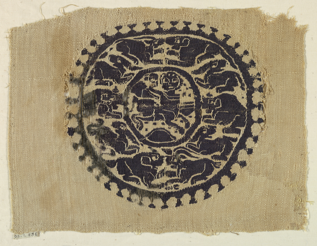 Monochrome circular medallion showing a centaur in the center surrounded by a variety of animals.