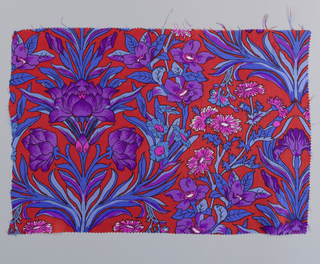Incomplete design of symmetrical arrangement of iris, with branching foilage, sprays of cornflowers and other blossoms in bright shades of purple, blue and pink on red ground.