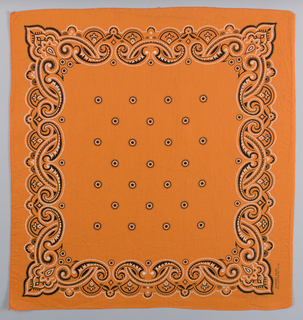 Square bandanas with design in black and white: a has cream ground; b has orange ground. Field of small dots, border of interlocking scrolls.