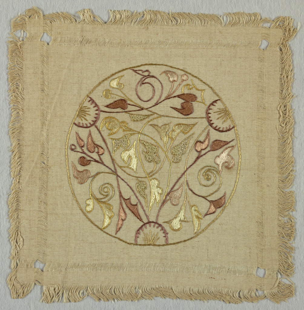 Doily embroidered in a circular, floral Art Nouveau pattern with multi-colored silk thread.