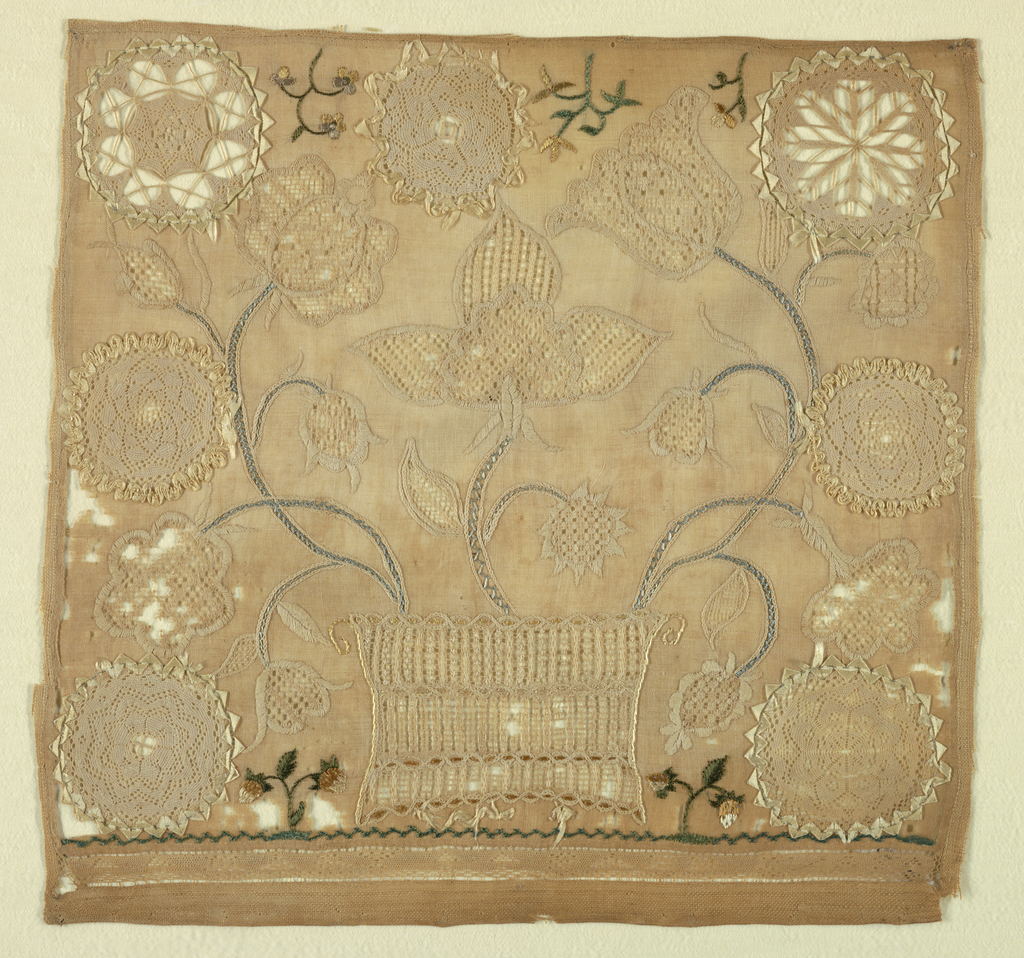 A basket of large flowers, with the flowers executed in drawn work, cut work, and hollie point in white embroidery on a white ground. The basket trimmings, stems of flowers, and isolated sprigs of flowers at bottom are worked in colored silks. With the inscription: Mary Babb 1783.