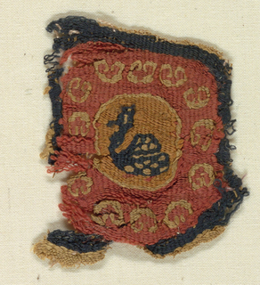 Small fragment with a long-necked crested bird swimming within a circular frame. Border of hearts.