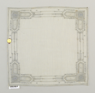 Handkerchief with embroidered border of rectangular shapes and floral sprays.