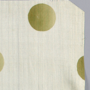Silk textile sample printed with pattern of green ombre circles against a white ground.