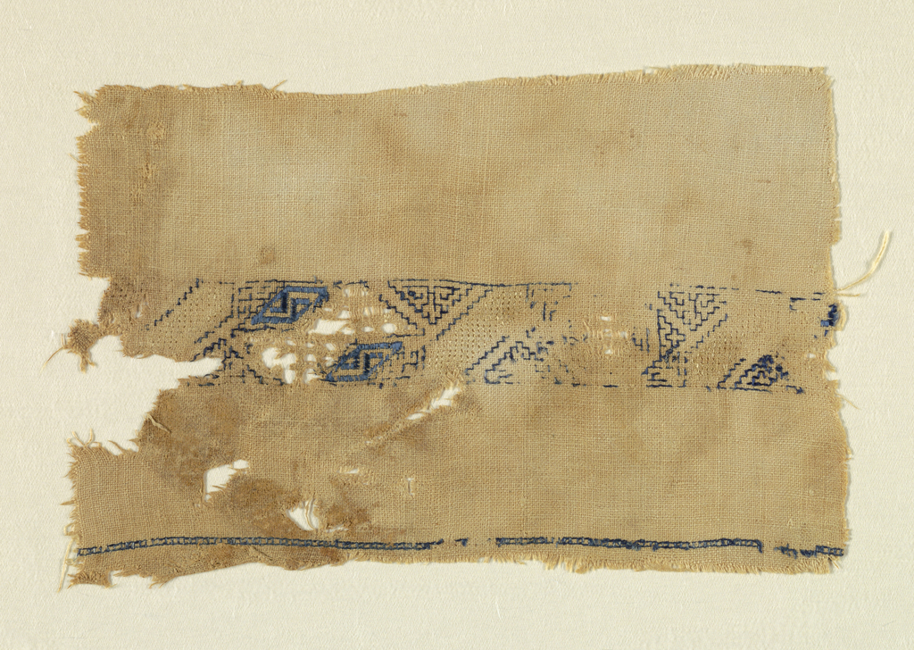 Fragment of a narrow band with blue geometric diagonals on natural linen. Early form of cutwork and double running stitch and hem stitch.