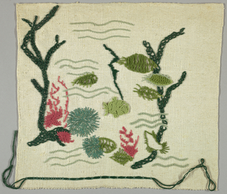 Square of white heavy cotton embroidered in shades of green and red in an abstract seaweed pattern.