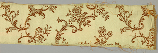 Orange/brown weft with tan warp forming floral pattern.