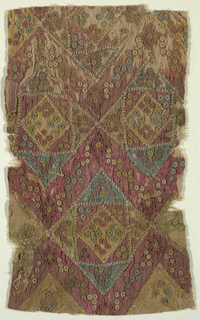 Fragment with a multicolored pattern of interlocking diamond shapes with buttonhole details.