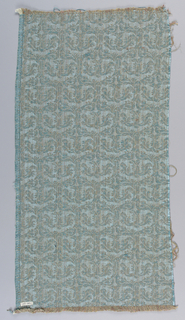 Sample of modern upholstery fabric. Woven in light blue, dark blue and reddish-brown. The design is taken from a textile in the Cooper-Hewitt collection; a printed cotton from Fustat.