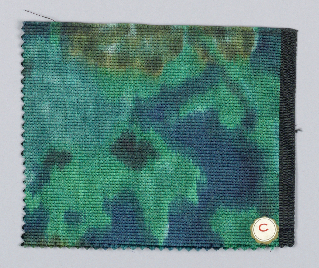 Diffuse allover floral pattern of green and brown on a dark blue ground.