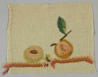 Square of light colored wool emboridered in shades of orange, pink, green and brown in an abstract design of two apples.