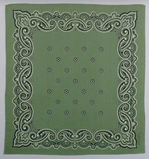 Square bandana with an olive green ground and design in black and white. Field of small circular motifs. Scalloped border made of interlocking scrolls.