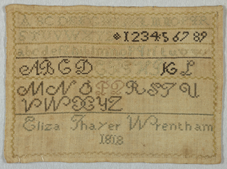 Several bands of alphabets and numerals, separated by narrow cross borders, and at the bottom the inscription.