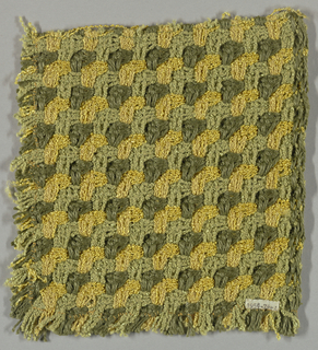 Sample in an allover chevron pattern in yellow, olive and light green. Coarse weave in a heavy stretchable material.