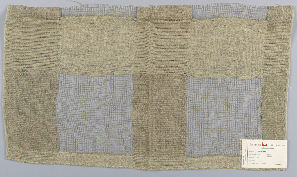 A variety of plain weave structures in beige are combined to form large squares.